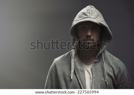 Young man wearing casual clothes posing on a gray background  - stock photo