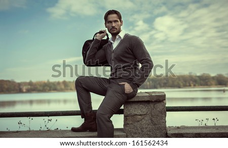 Young man wearing fashion clothes - stock photo