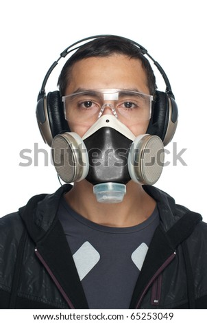 Young Man Wearing Goggles, Respirator and Hearing Protection. Isolated on white background.