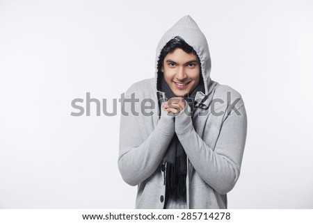 Young man wearing jacket feeling cold - stock photo
