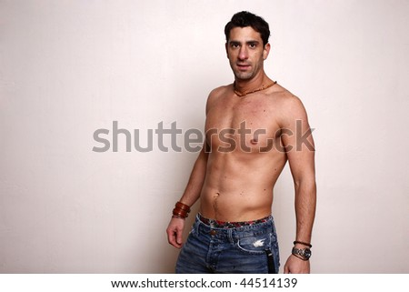 Young man wearing jeans and no shirt.