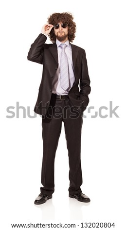 young man wearing suit and sunglasses isolated on white background - stock photo