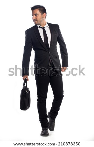 Young man wearing suit walking with a briefcase isolated on white background - stock photo
