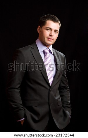 Young man wearing suit with tie - stock photo