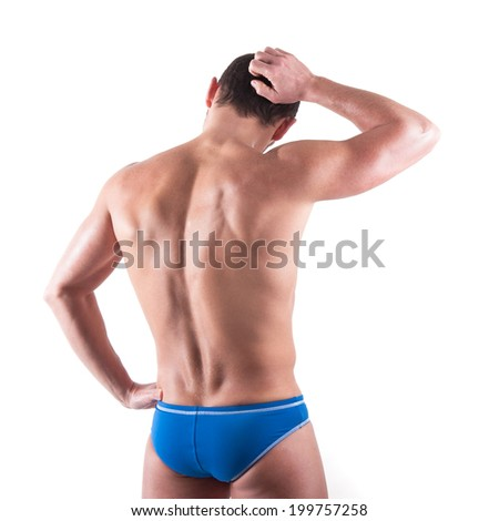 Young man wearing swimsuit from behind isolated over white background.