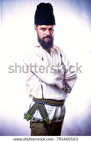 young man wearing traditional romanian costume