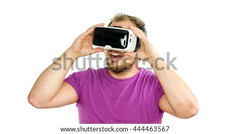 Young man wearing virtual reality VR glasses / googles. Isolated on white