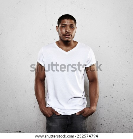 Young man wearing white blank t-shirt - stock photo