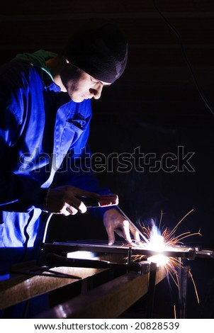 young man welding