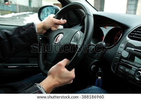 Young man who's driving, steering wheel