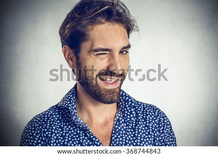 Young man winking