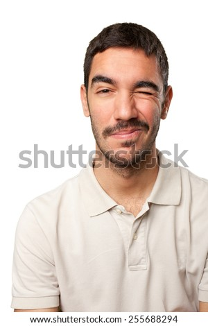Young man winking an eye - stock photo