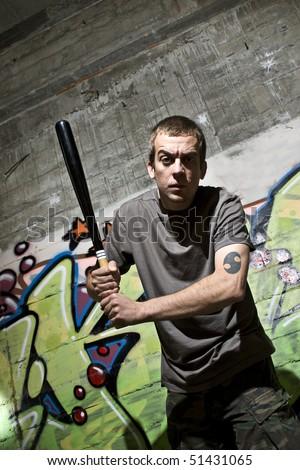 Young man with a baseball bat - stock photo