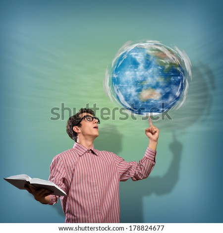 young man with a book thinks. keeps the finger symbol of the planet Earth. Elements of this image furnished by NASA,