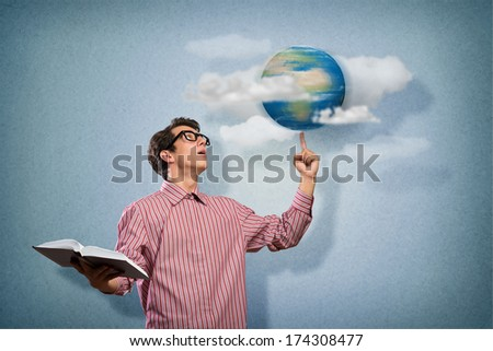 young man with a book thinks. keeps the finger symbol of the planet Earth. NASA images used