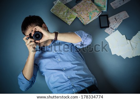 Young man with a camera - stock photo