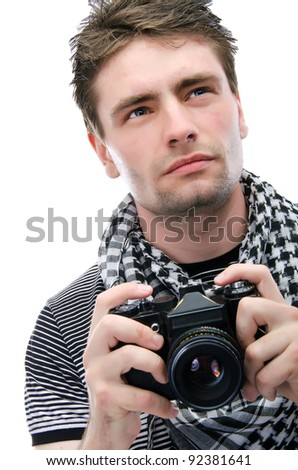 Young man with a camera, isolate - stock photo