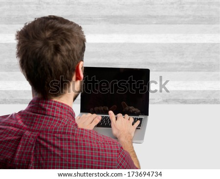 young man with a computer on a table