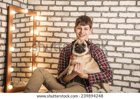 young man with a dog - stock photo
