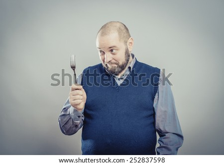 young man with a fork - stock photo
