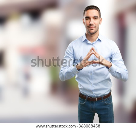Young man with a gesture of confidence - stock photo