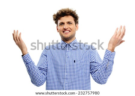 Young man with a kind of uncomprehending opened his arms to the sides - stock photo