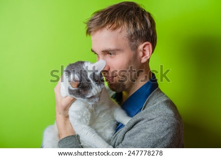 young man with a love of animals - stock photo