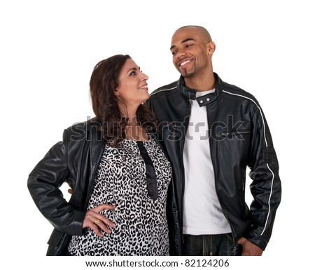 Young man with a mature woman, smiling and looking at each other.