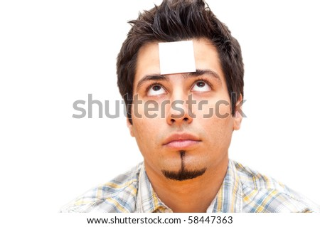 young man with a note stuck to his forehead - stock photo