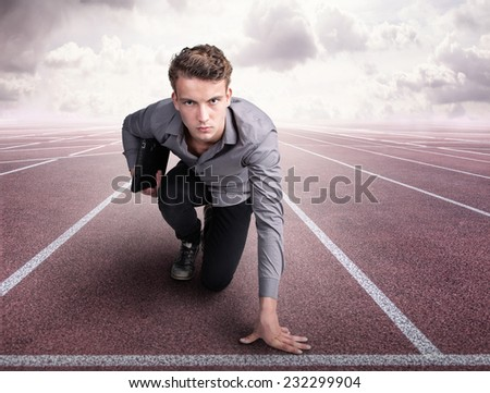 Young man with a notebook is ready for the start - stock photo