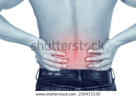 young man with a pain in a waist on a white background. Rear view of a young male  - stock photo