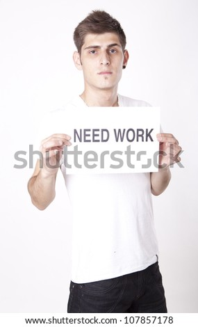 Young man with a sign need work - stock photo