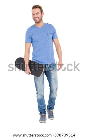 Young man with a skateboard on white background