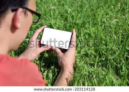 young man with a smartphone watching - stock photo