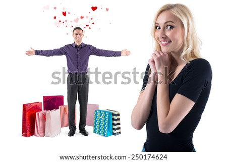 young man with a smile and flying hearts around  standing with bags gifts presents after shopping congratulate to happy and gorgeous girl. - stock photo