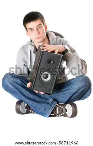 Young man with a speaker in his hands - stock photo