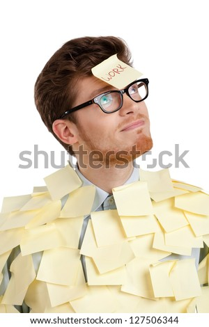 Young man with a sticky note on his face, covered with yellow stickers, isolated on white on white