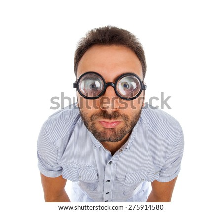 Young man with a surprised expression and thick glasses on white background. - stock photo