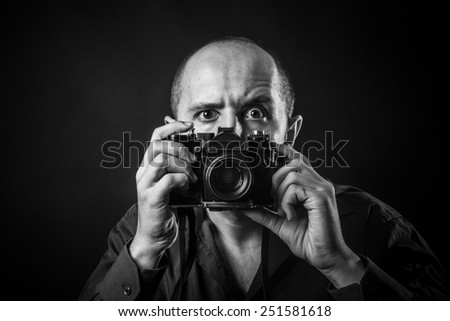young man with a vintage camera - stock photo