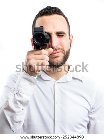 Young man with a vintage video camera - stock photo