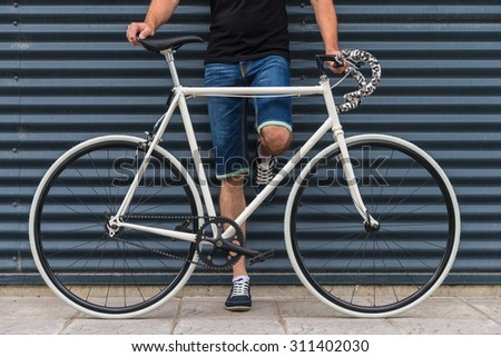 Young man with a white fixie bike