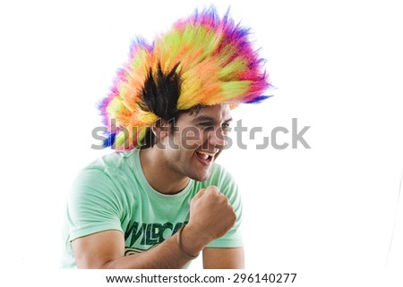 Young man with a wig cheering