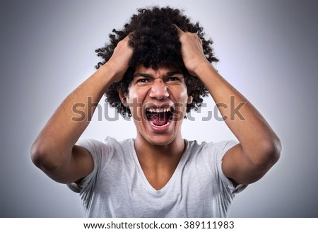 Young man with afro shouting