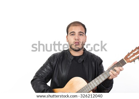 Young Man With an Old Acoustic Guitar Isolated on White - stock photo