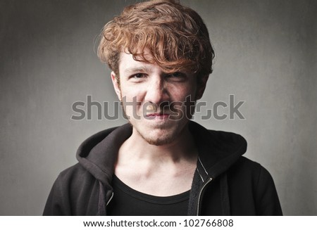 Young man with angry expression - stock photo