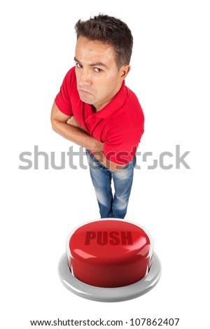 young man with arms crossed on top of a red button