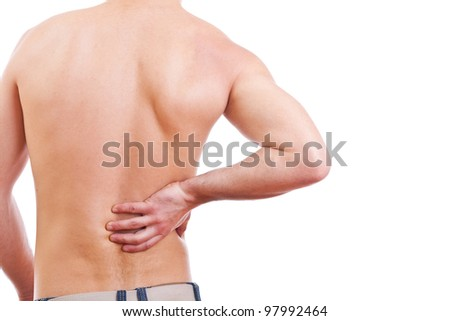 Young man with back pain - stock photo