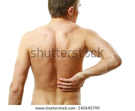 Young man with back pain. Isolated on white background - stock photo
