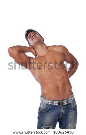 Young man with back pain massaging his muscles (isolated on white) - stock photo