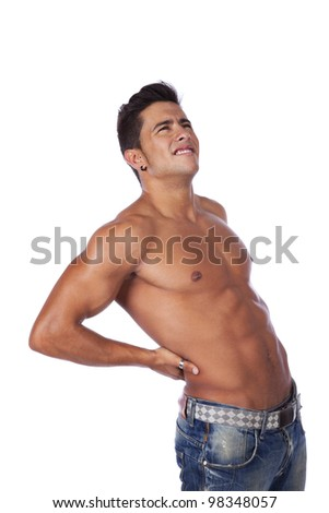 Young man with back pain massaging his muscles (isolated on white)